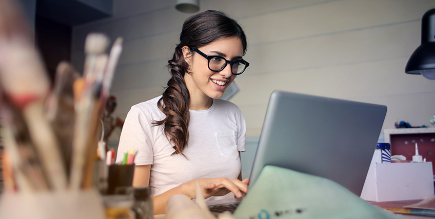woman-using-her-laptop